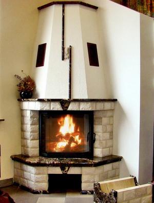 Угловой камин для уюта в доме